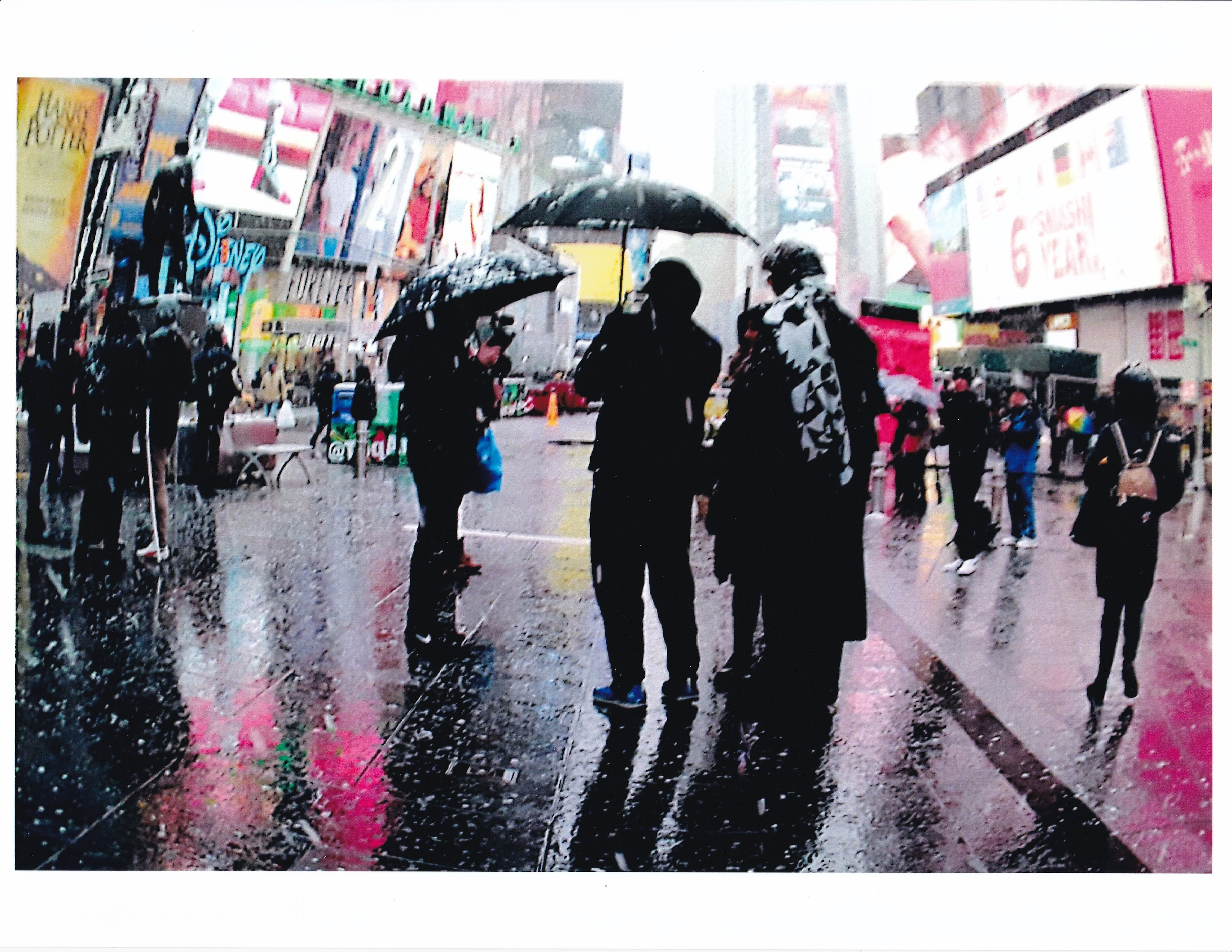 a rainy, atmospheric scene with people holding umbrellas in Times Square